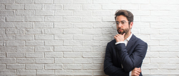 young-friendly-business-man-thinking-looking-up-confused-about-idea-would-be-trying-find-solution_1187-14777-1